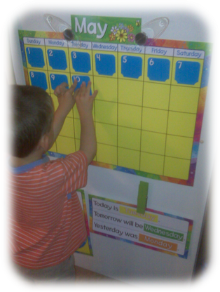 Child putting numbers on calendar
